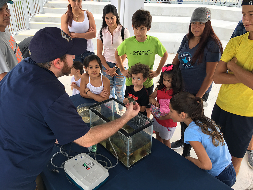 Nick Ogle showing marine animals to park attendees.