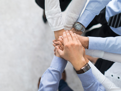 Group huddle - hands in the middle