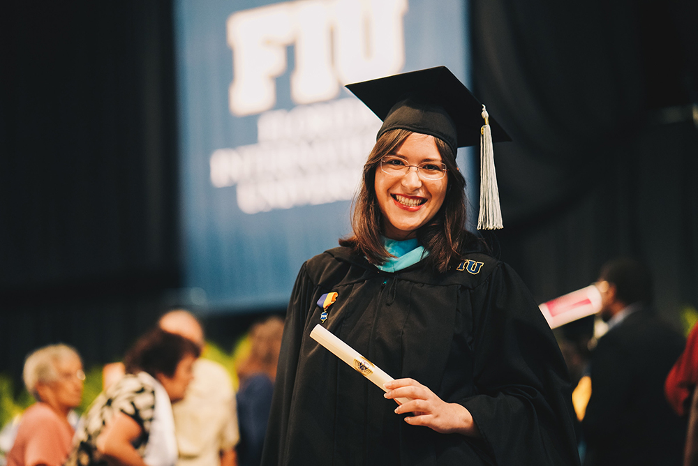 Gisela Valencia holding diploma